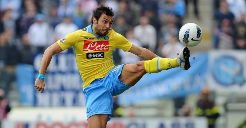 PARMA, ITALY - MARCH 04 Andrea Dossena of SSC Napoli leaps to control the ball during the Serie A match between Parma FC and SS